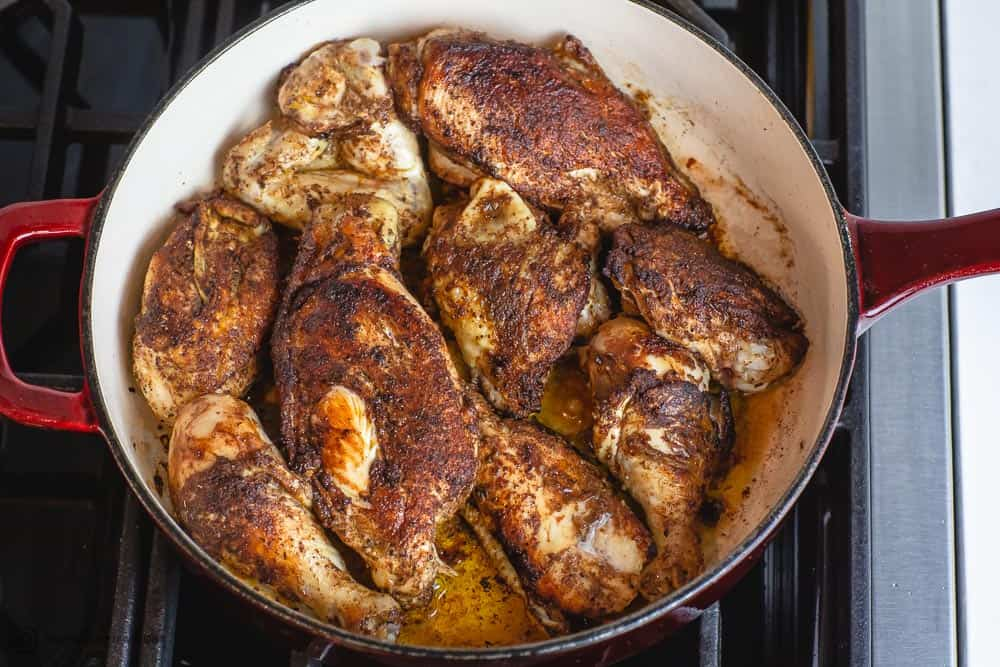 Moroccan chicken being browned in braiser