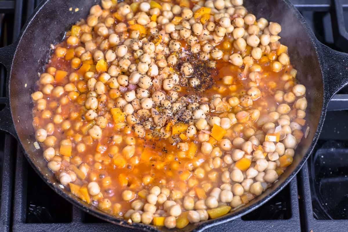 Chickpeas cooking in red sauce