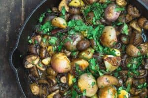 Shallot Garlic Mushroom recipe. Served in large cast iron skillet with parsley garnish.