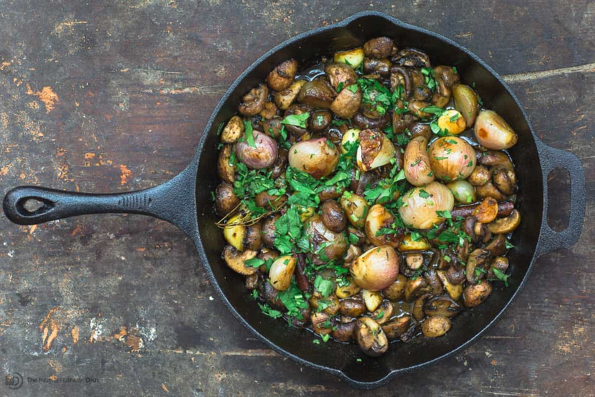 Shallot garlic mushrooms in skillet, garnished with parsley