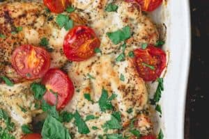 Italian Baked Chicken with Tomatoes. Garnished with Basil and Parsley