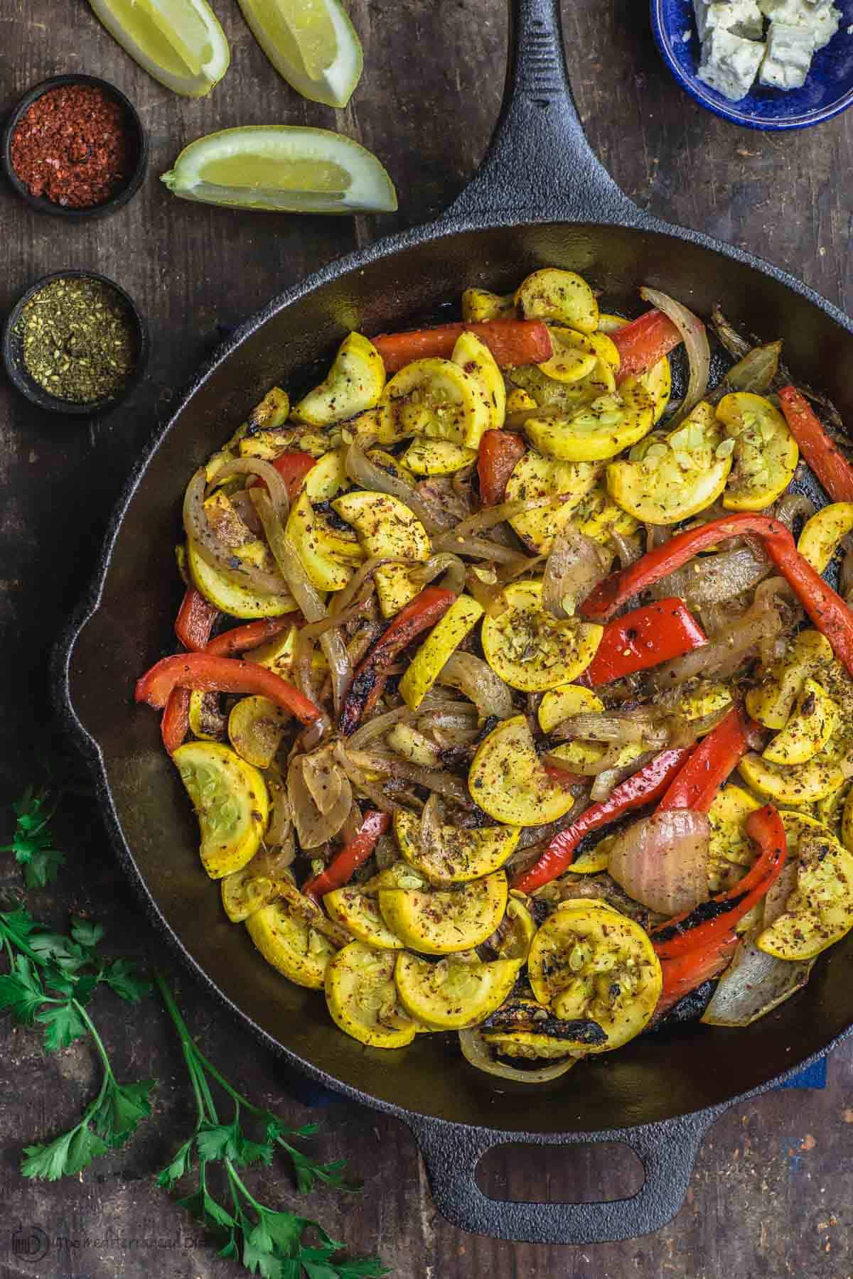 Mediterranean Sauteed Yellow Squash with Sweet Onions, Bell Peppers and Garlic in Cast Iron Skillet