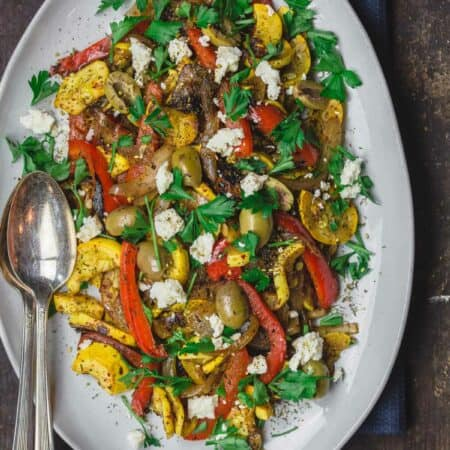Sauteed Yellow Squash with Sweet Onions and bell peppers. Served with a garnish of feta cheese, olives and parsley