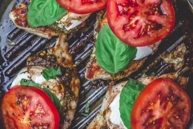 Easy Caprese Chicken with basil pesto, fresh mozzarella, ripe tomatoes, and balsamic glaze