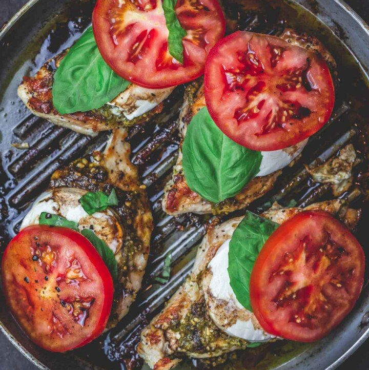 Easy Caprese Chicken with basil pesto, fresh mozzarella, ripe tomatoes, and balsamic glaze