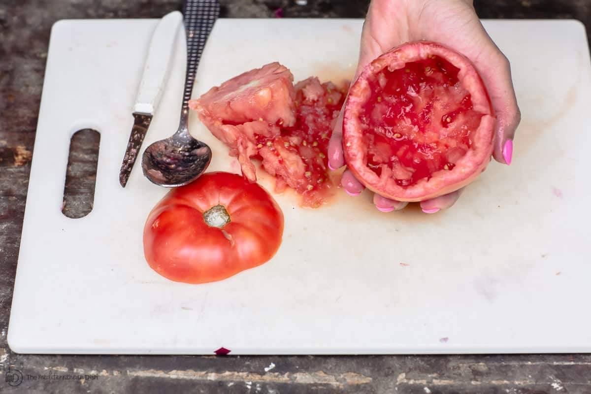Tomato completely cored and emptied to be stuffed