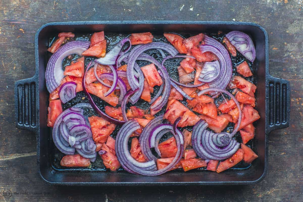 Baking sheet with onions and tomatoes