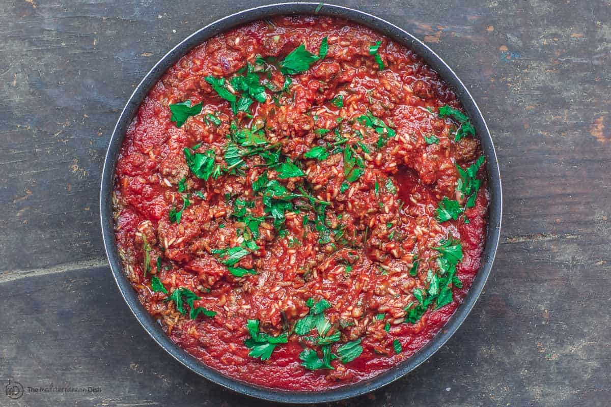 Meat and rice mixture with tomato sauce. Stuffing for tomatoes