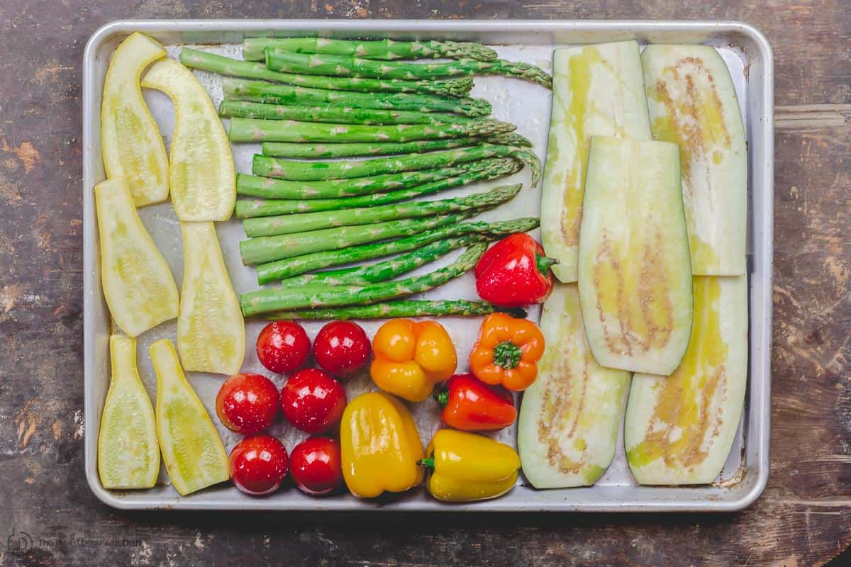 Raw vegetables prepared for grilling. Drizzled with extra virgin olive oil