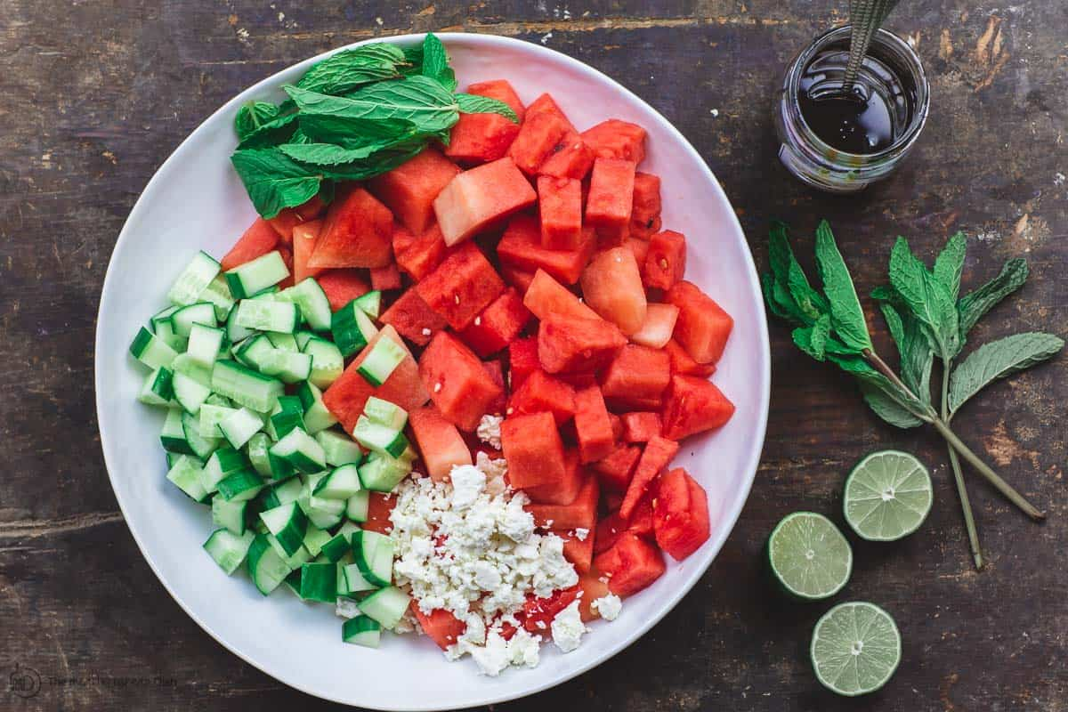 Watermelon, Cucumber, Feta, and Fresh Herbs in one large bowl