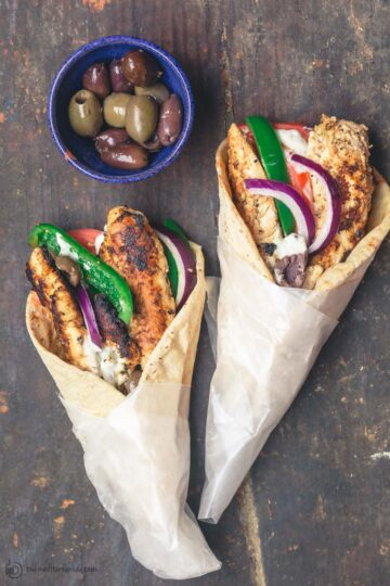 Chicken gyros wraps served with black and green olives