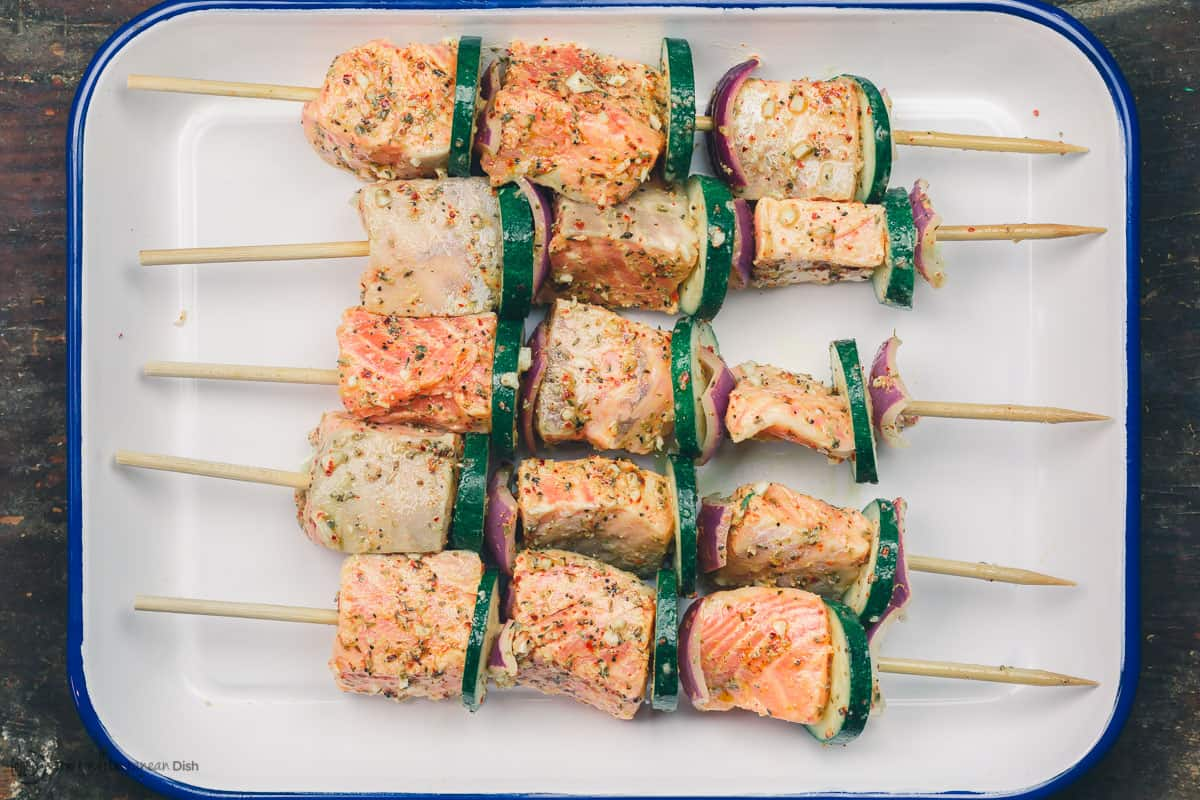 Salmon prepared on skewers with zucchini and red onion