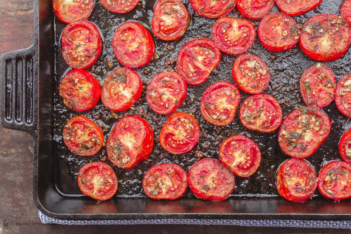 Tomatoes roasted in oven placed in cast iron pan