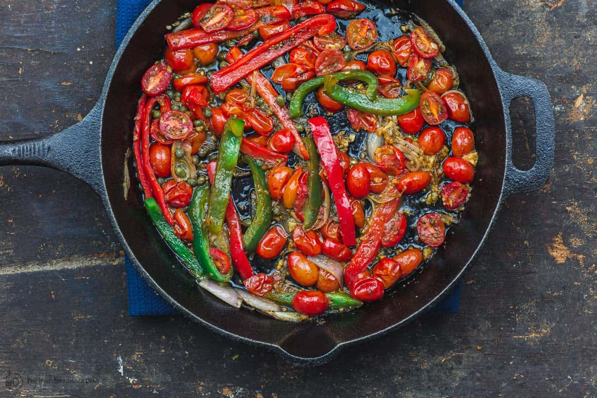 Tomatoes and bell peppers sauteed in skillet