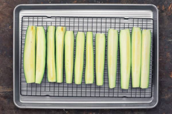 Zucchini Sticks placed on a baking sheet prior to baking