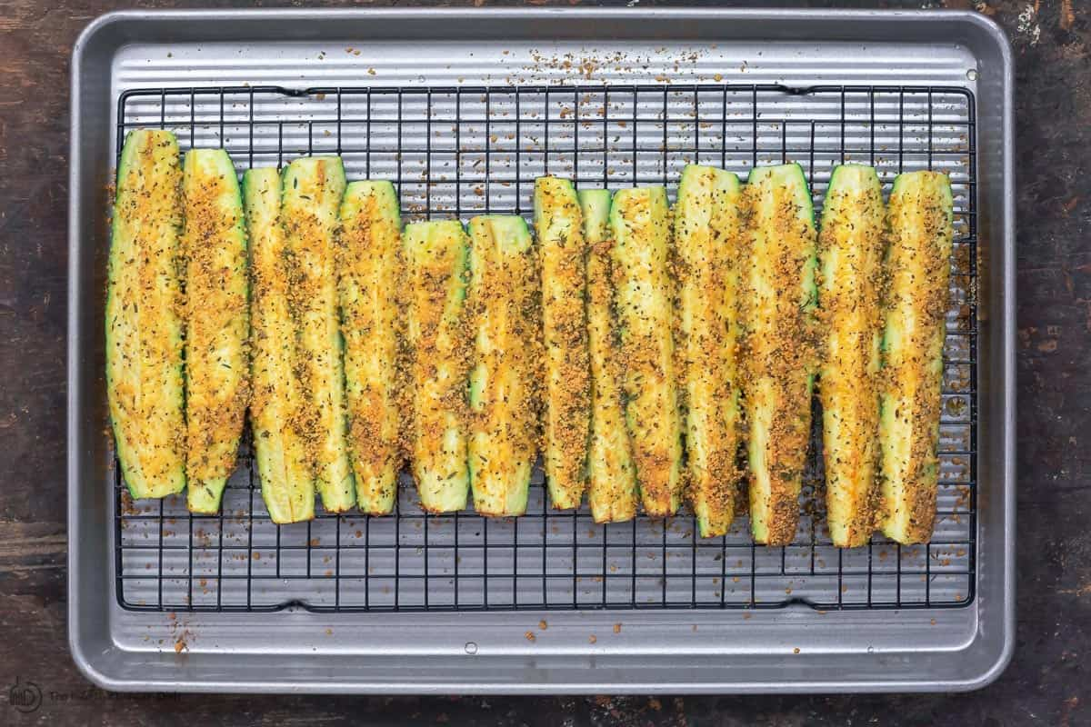 Baked zucchini sticks with crispy golden Parmesan topping