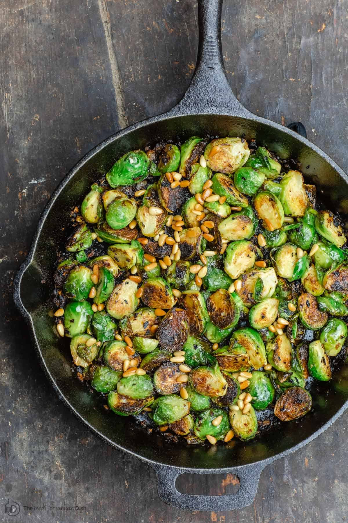 Brussel sprouts in a cast iron frying pan