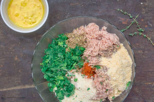 Chicken meatball mix prepared in mixing bowl