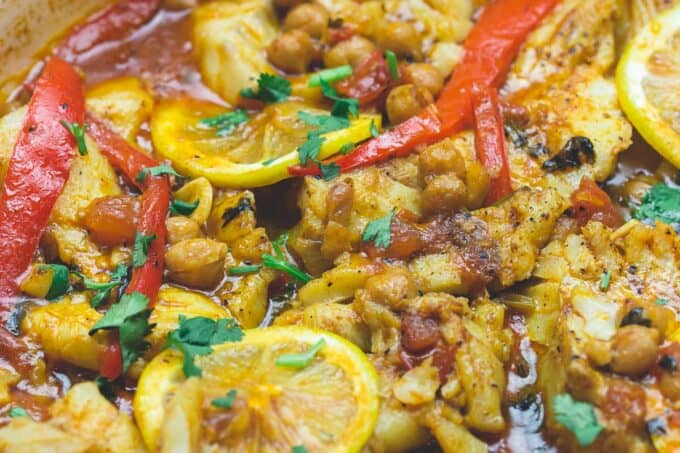 Braised cod fish in pan with Moroccan flavors. Moroccan fish