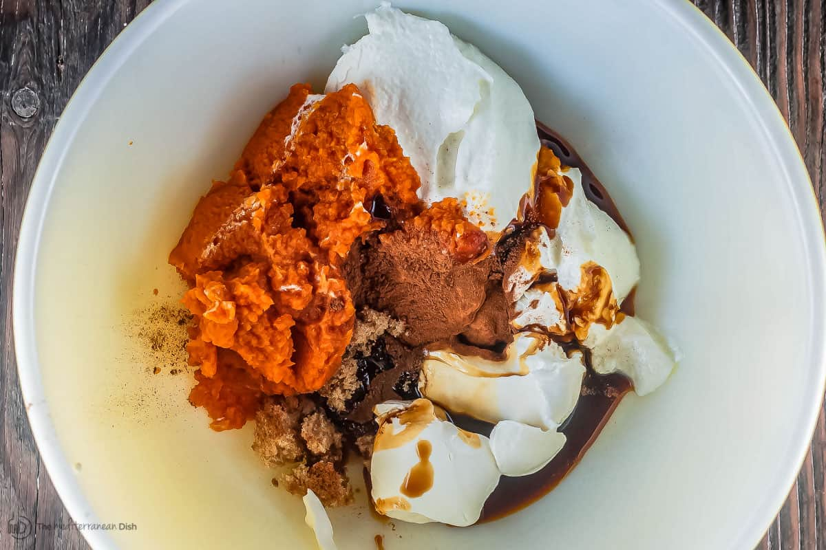 Pumpkin parfait ingredients in a large mixing bowl