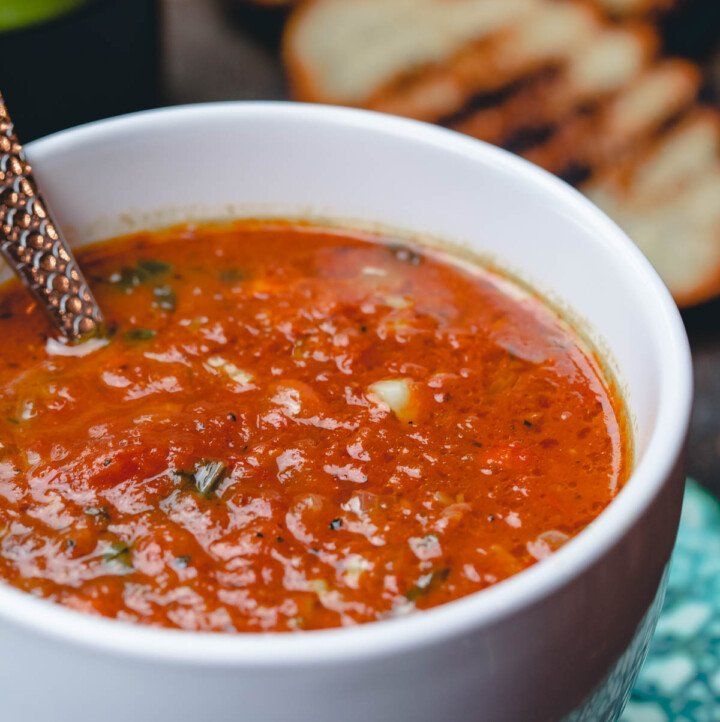 Roasted Tomato Basil Soup served in cups with grilled bread slices