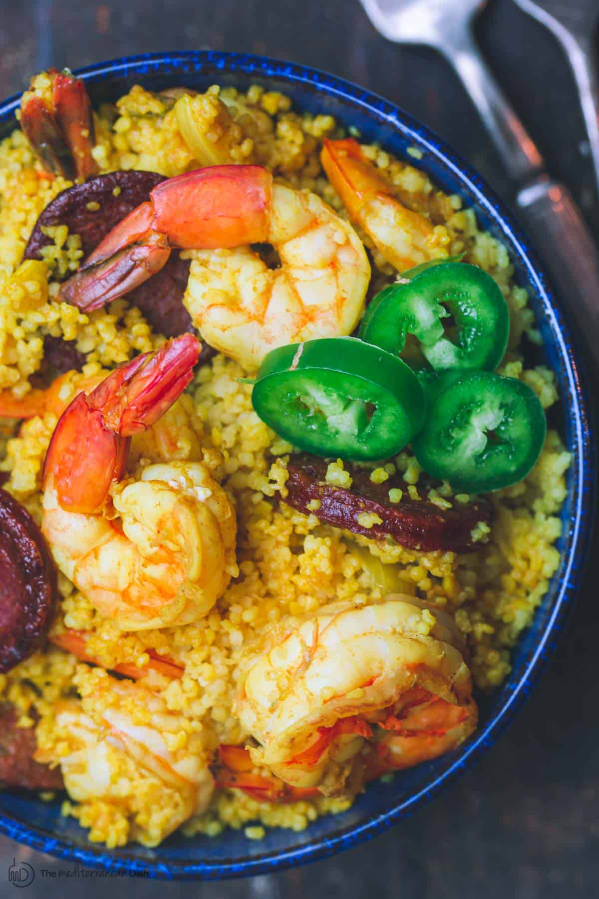 Spicy shrimp with couscous and chorizo in a small bowl