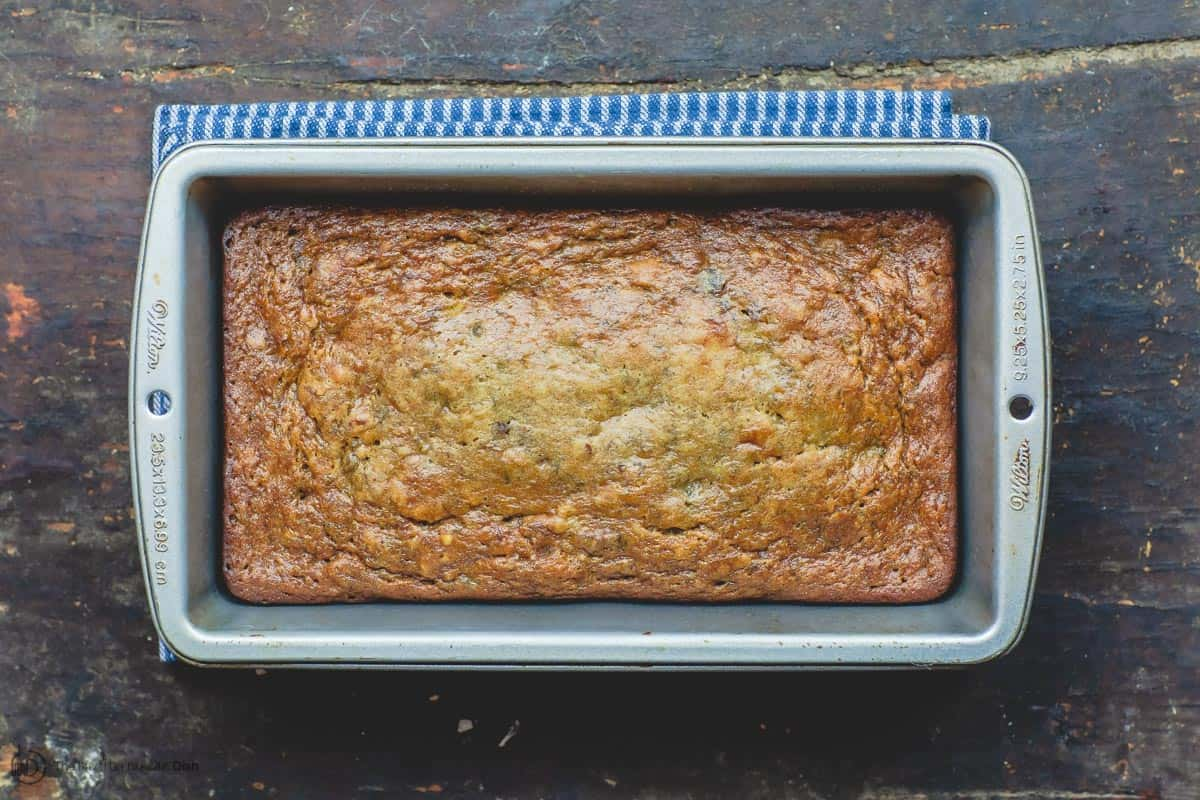Loaf of banana walnut bread in baking pan