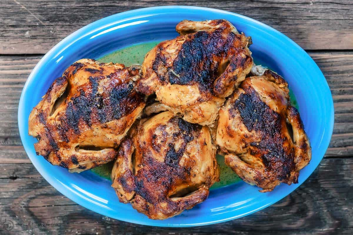 Baked Cornish Hens on blue serving platter
