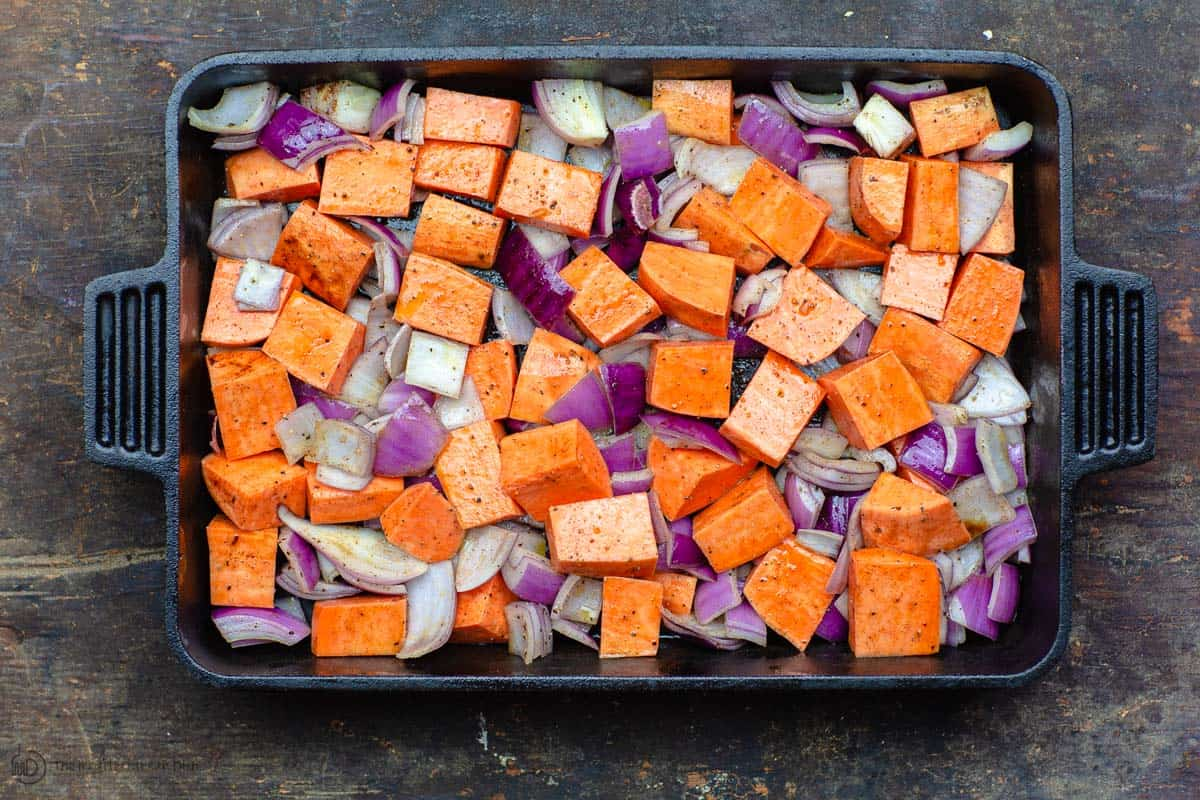Freshly diced sweet potatoes and onions in baking pan
