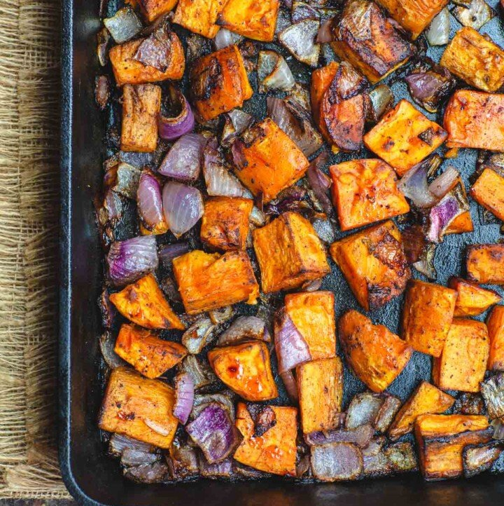 Diced sweet potatoes and onions roasted in cast iron pan