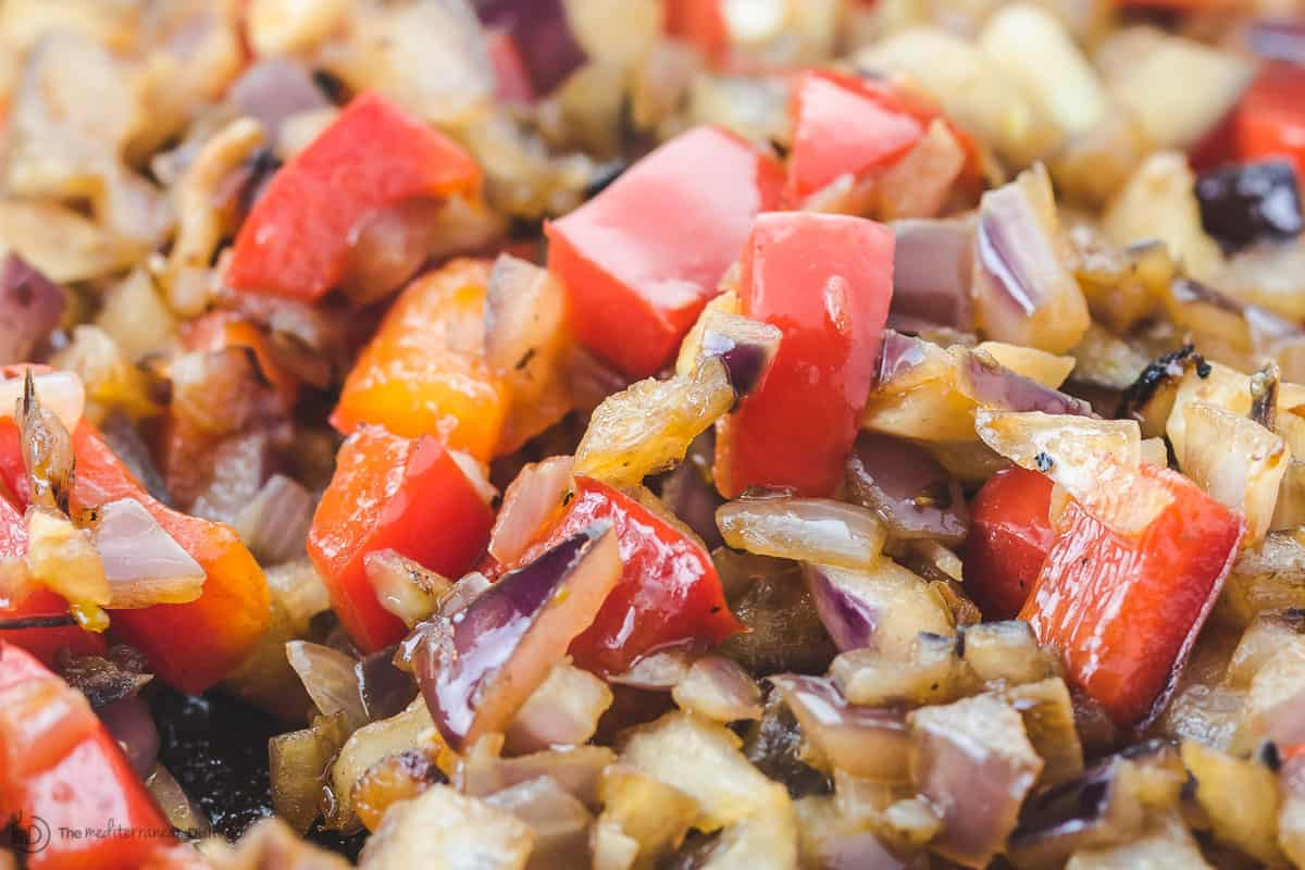 Sauteed red onions and diced red bell peppers