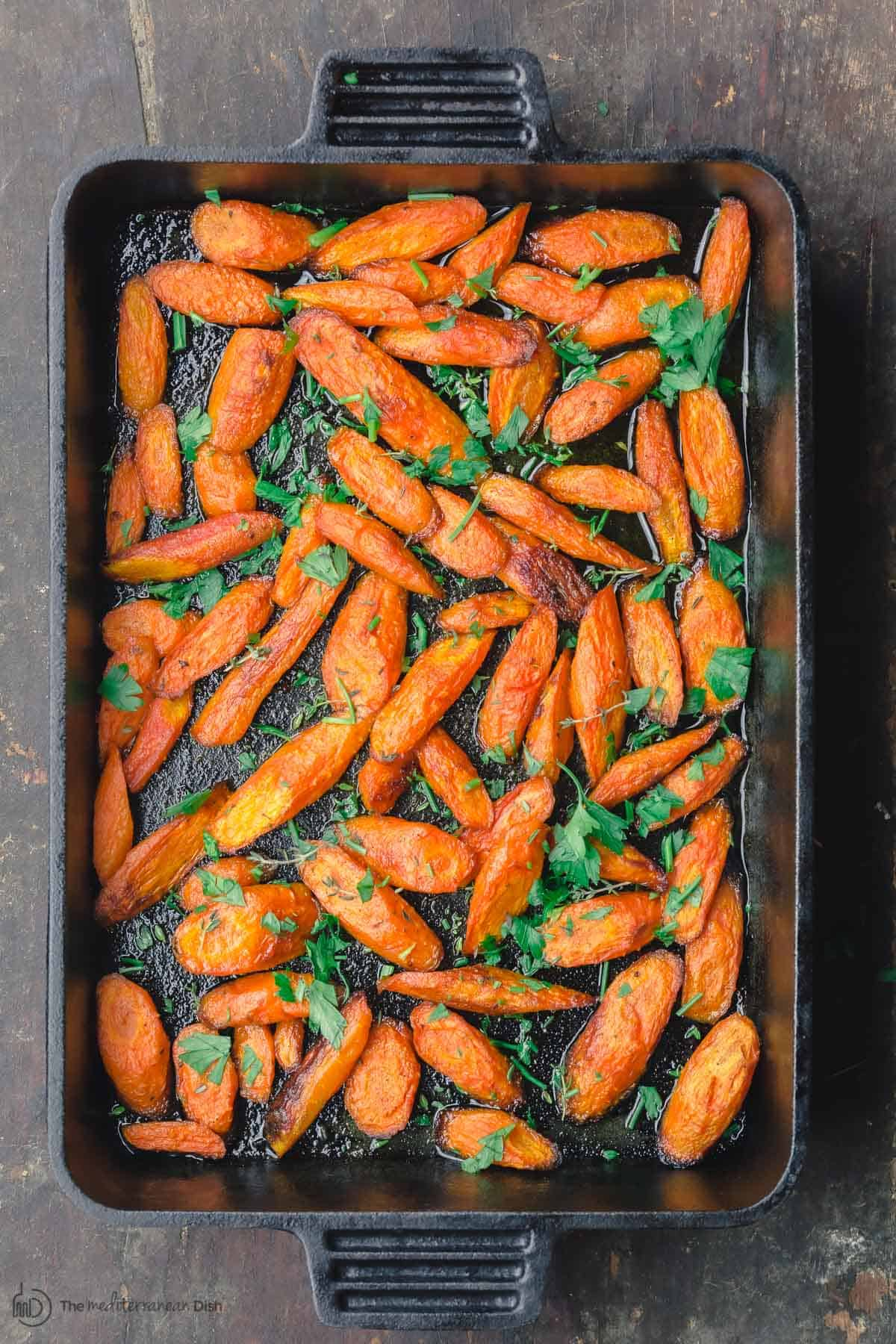 Roasted carrots in large baking pan