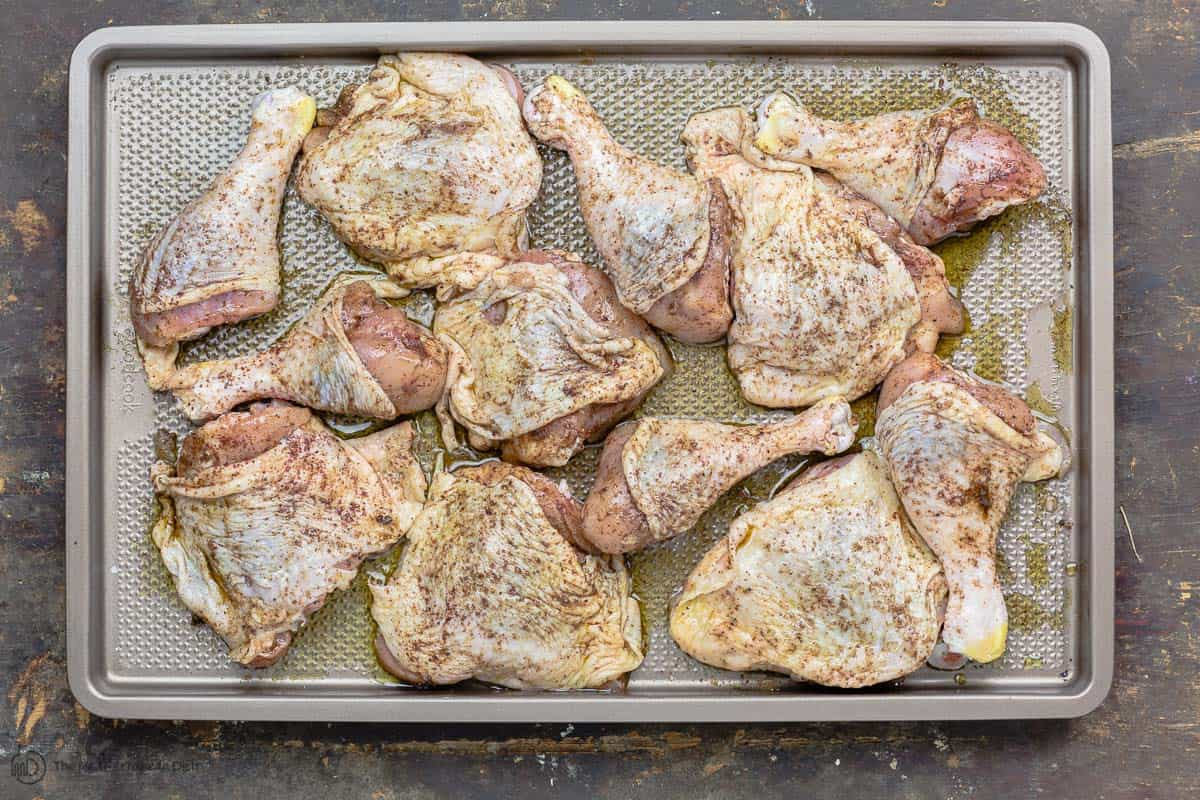 Chicken pieces that have been seasoned with salt and spice mixture for musakhan