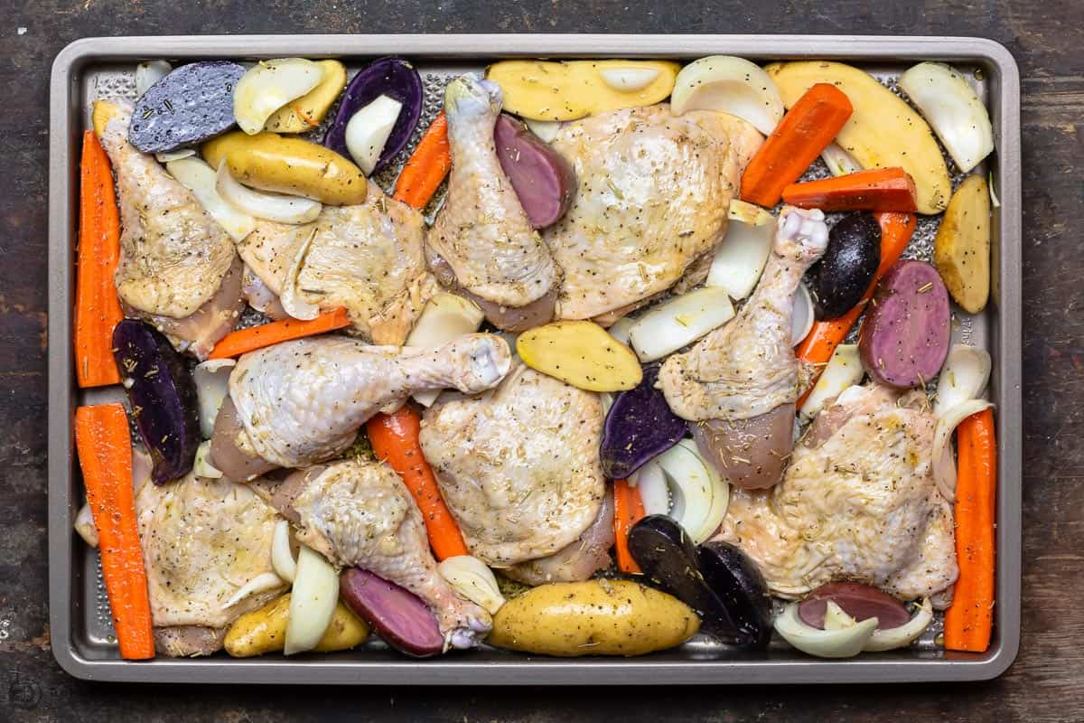 Vegetables and chicken on baking sheet before baking
