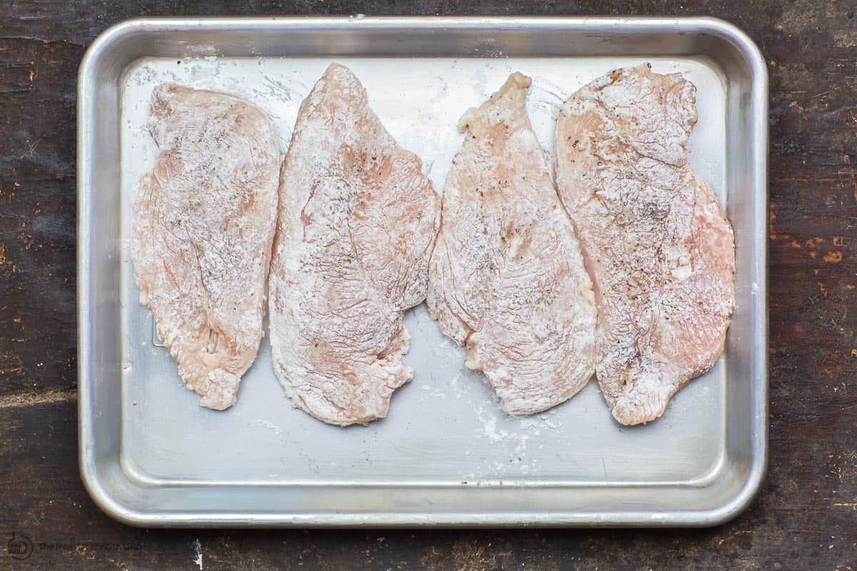 Chicken breast cutlets dredged in flour