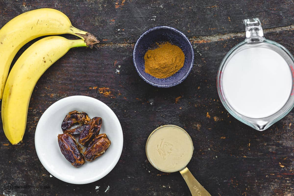 Ingredients for date banana shake. Bananas, almond milk, medjool dates, tahini, and cinnamon