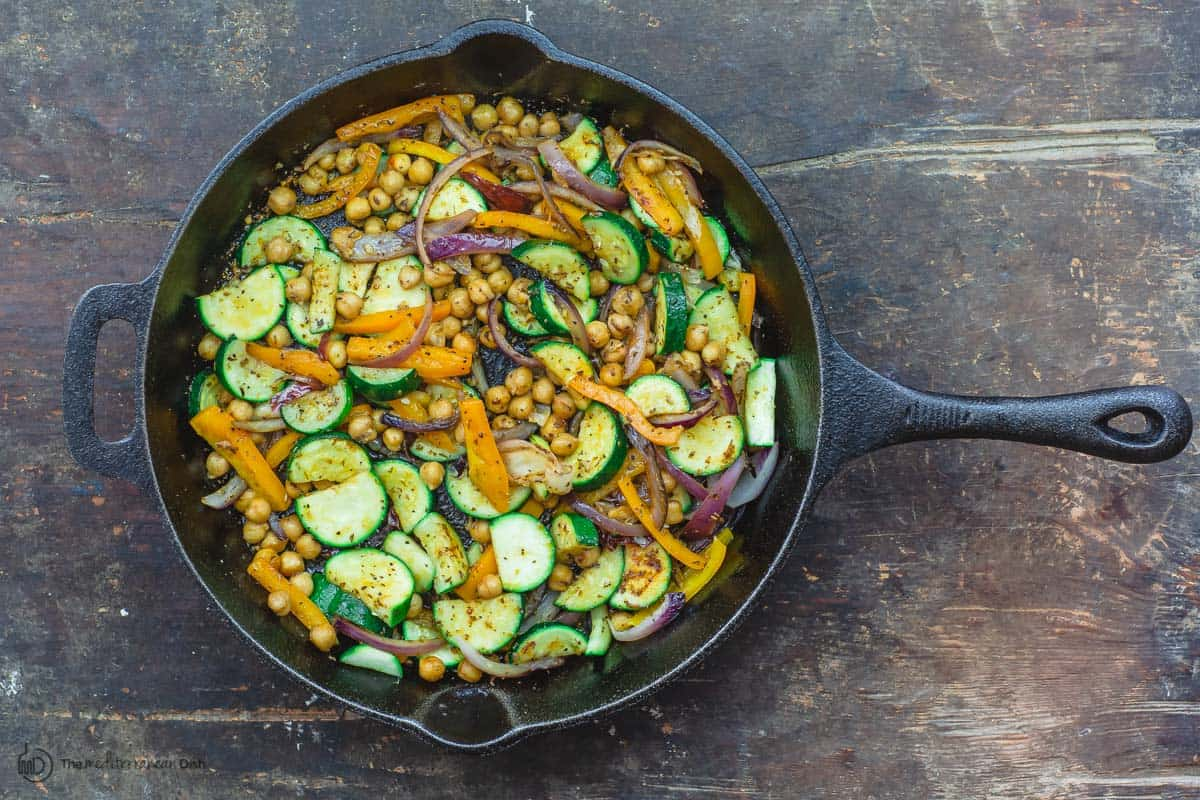 Sauteed vegetable and chickpeas in skillet