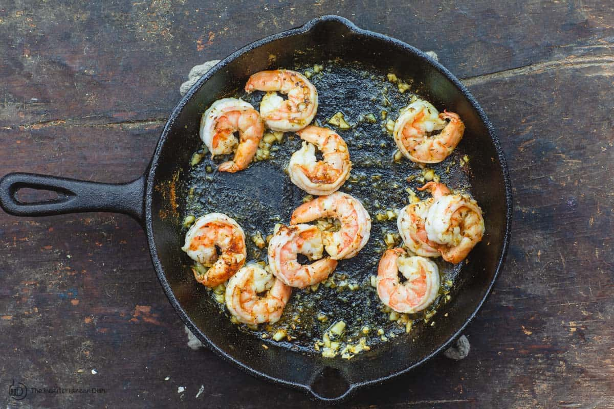 Shrimp sauteed in skillet with garlic and olive oil