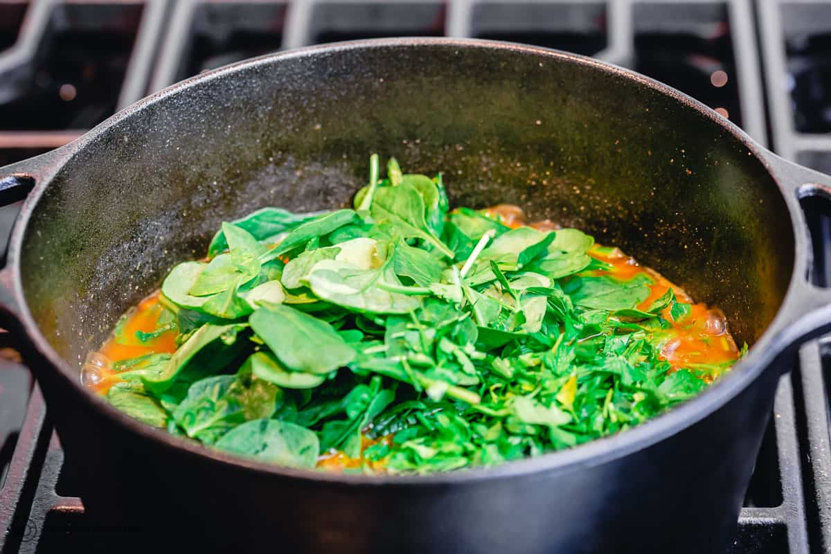 baby spinach is added to sweet potato stew
