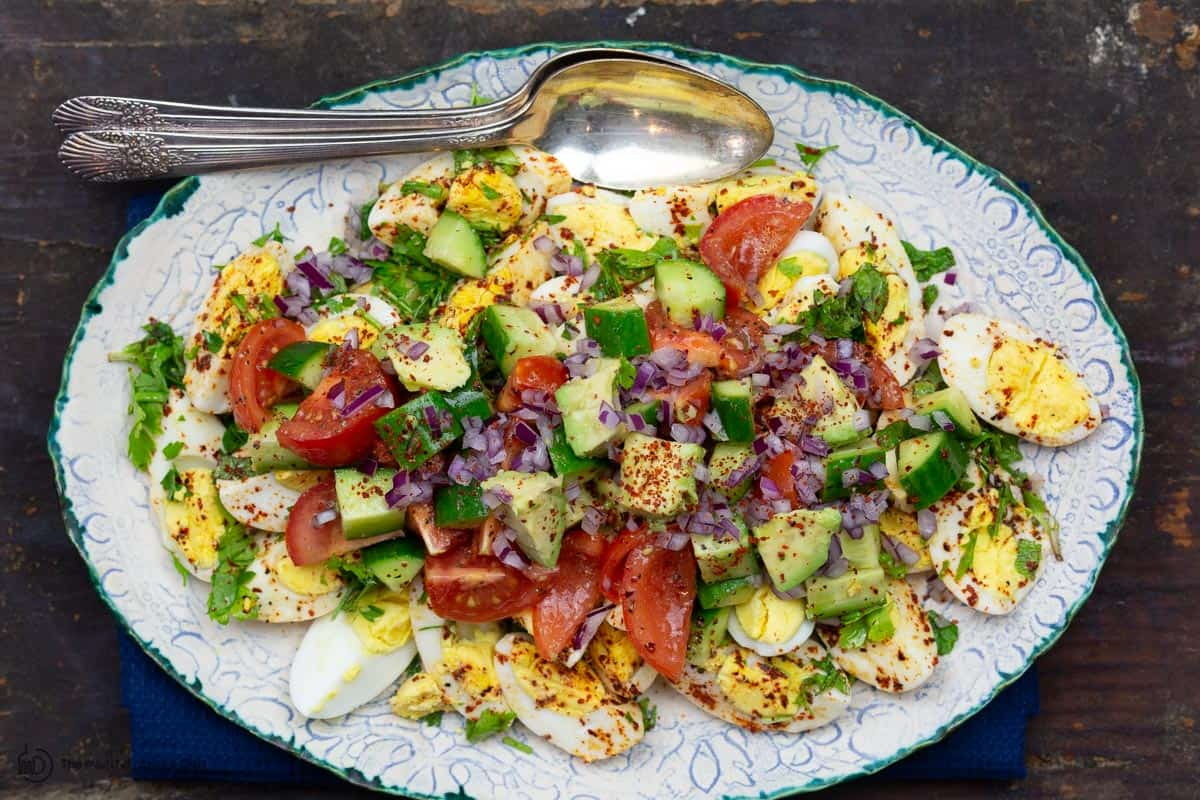 Vegetables added on top of eggs for healthy egg salad