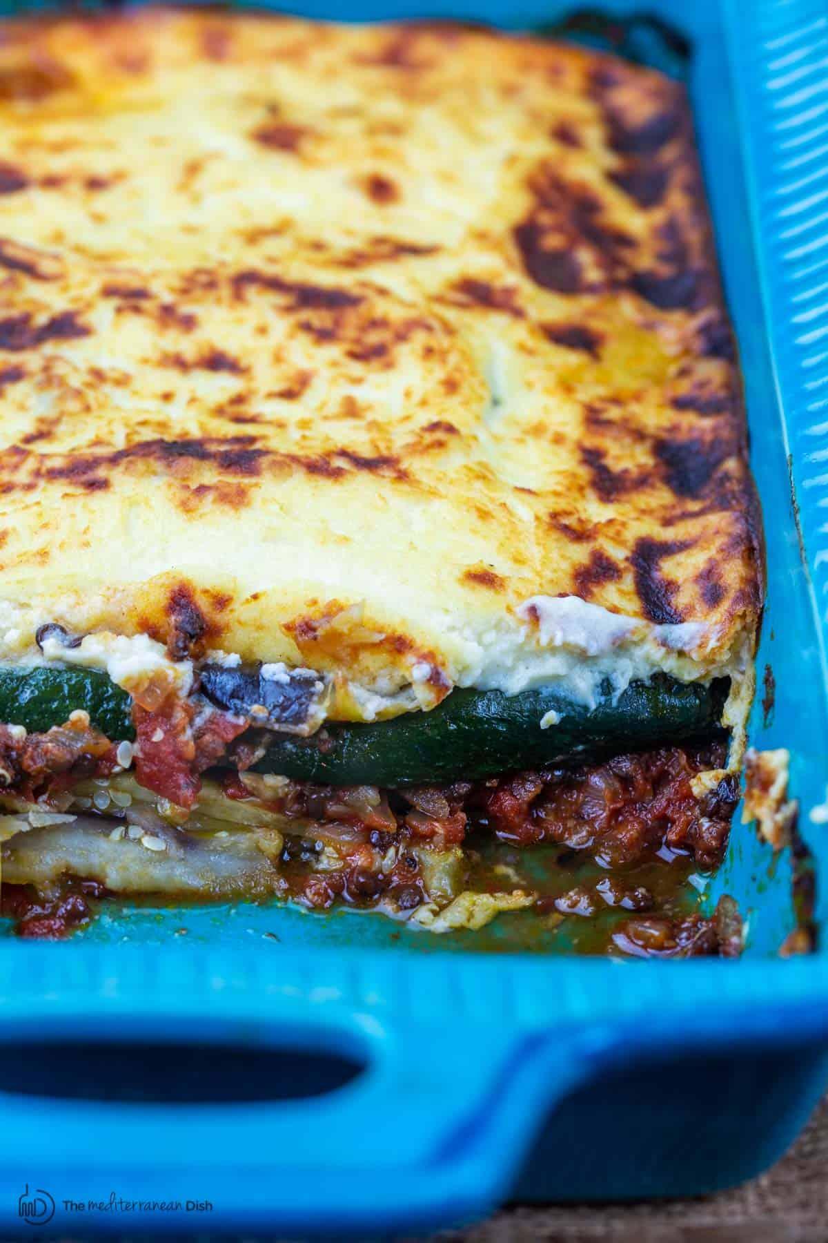 Vegetarian moussaka in blue baking dish