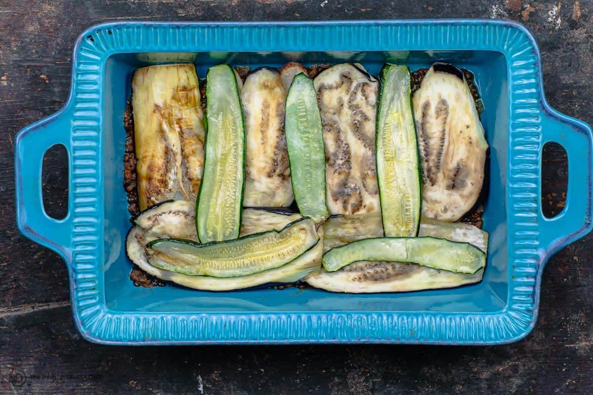 Roasted vegetables layered in baking pan