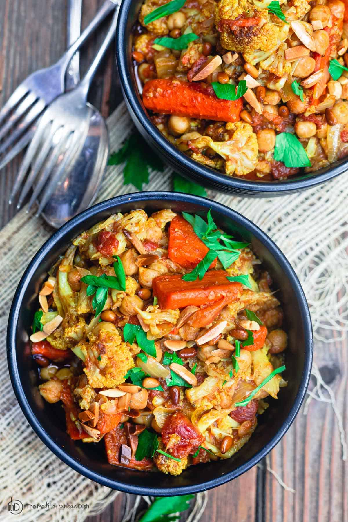 chickpea stew with cauliflower and carrots, served in dinner bowls