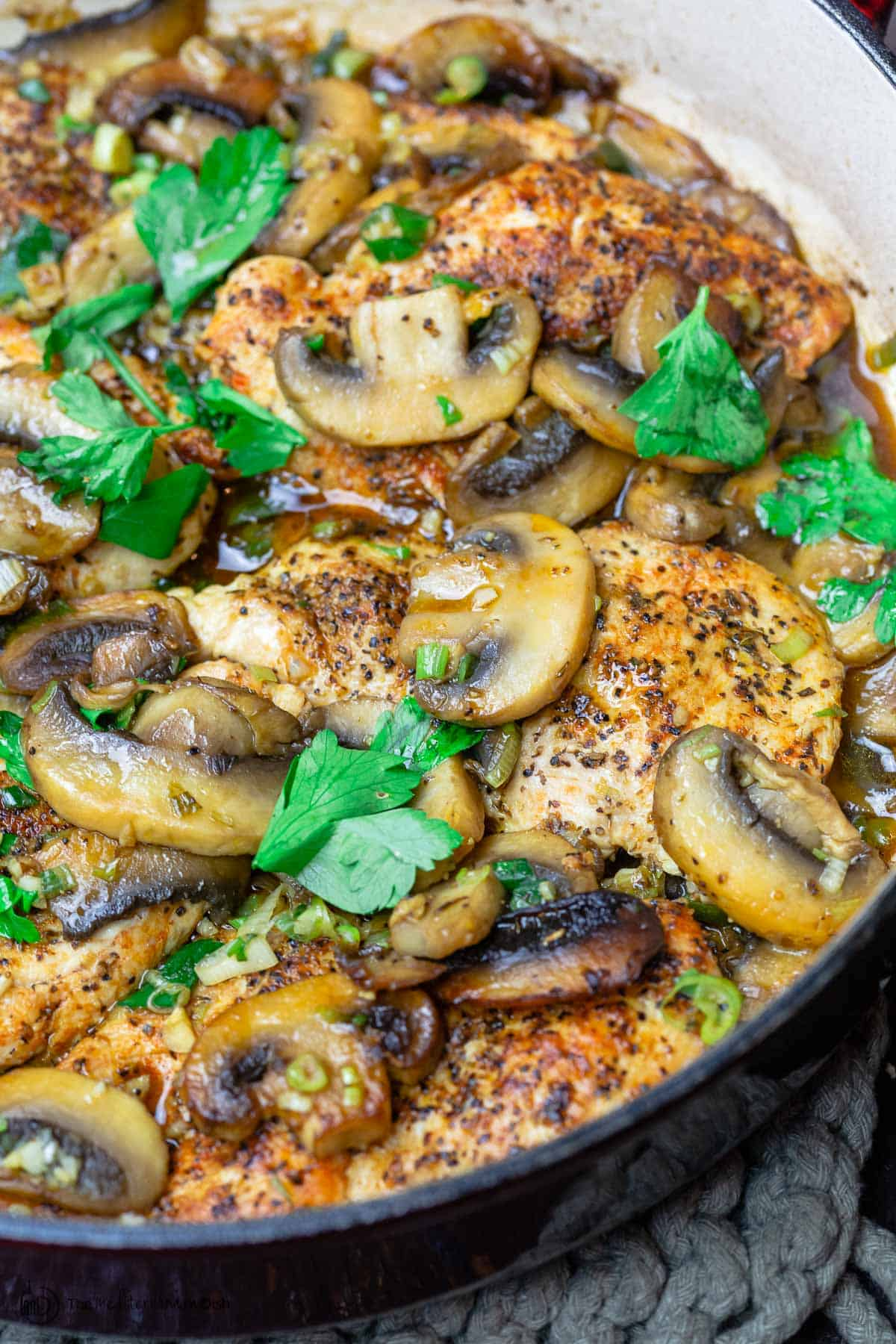 Chicken and mushrooms garnished with parsley