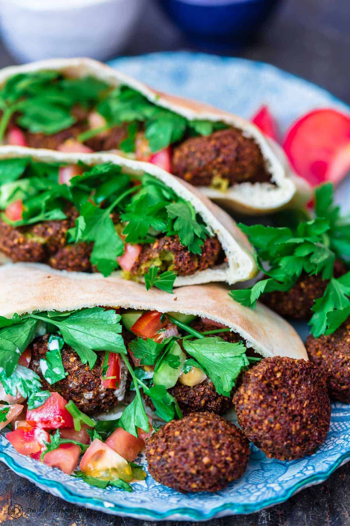 Falafel in pit pockets with garden vegetabiles and tahini