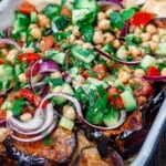 Mediterranean chickpea salad with a side of eggplant and pita
