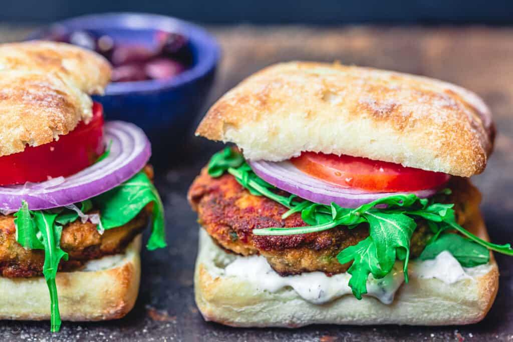 Mediterranean salmon burgers, assembled in ciabatta buns