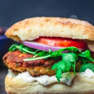 juicy salmon burger in ciabatta bun