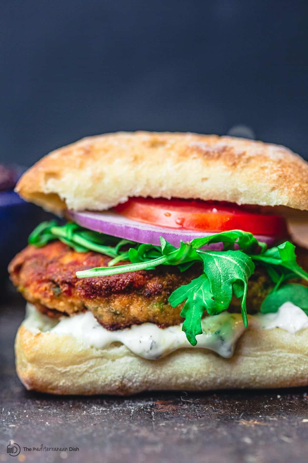 juicy Mediterranean-style salmon burgers in ciabatta bun