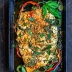 Marinated baked fish with garlic, basil, and bell peppers